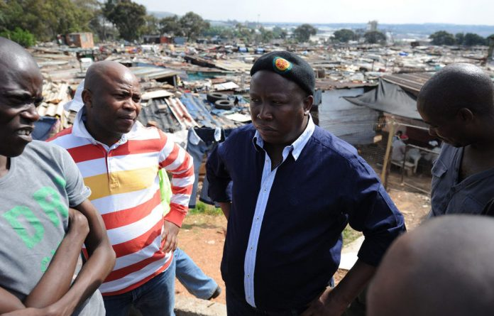 Expelled ANC Youth League leader Julius Malema arrives in Slovo Park informal settlement in Johannesburg.