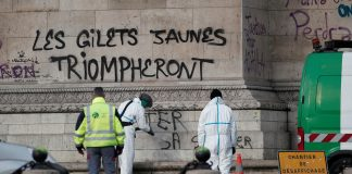 """""""The yellow vests will triumph"""" is seen written on the Arc de Triomphe"""