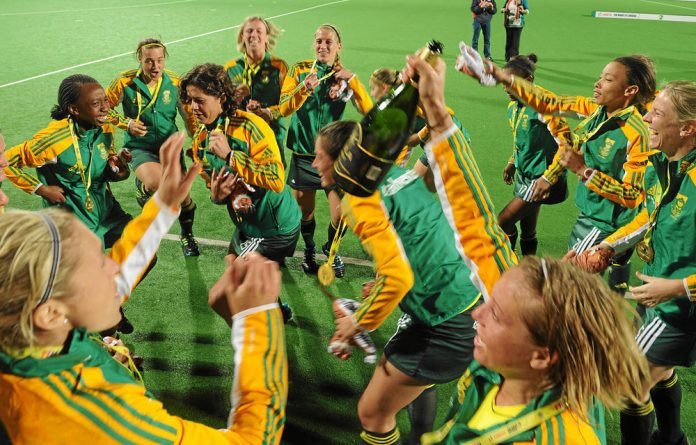 Cheers: The women's hockey team celebrate after beating India to qualify for the Olympic Games in London.
