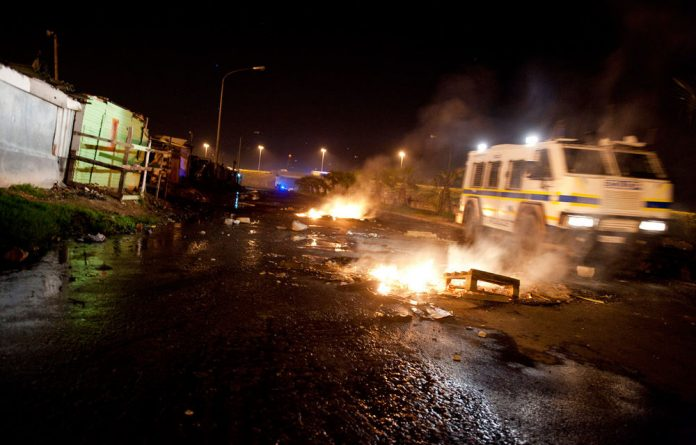 A man has been found dead after protests in Khayelitsha over service delivery turned violent.