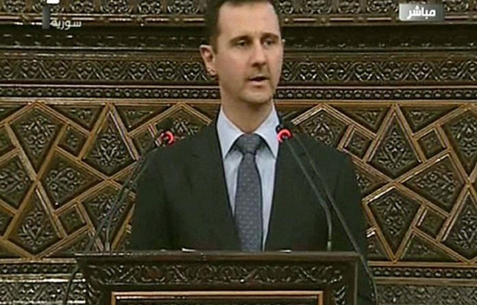An image grab taken from Syrian state TV shows Syrian President Bashar al-Assad addressing the parliament in Damascus on June 3