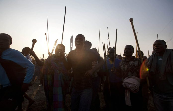 Over 30 people were killed when police open fire on a crowd of protesting mine workers in Marikana.