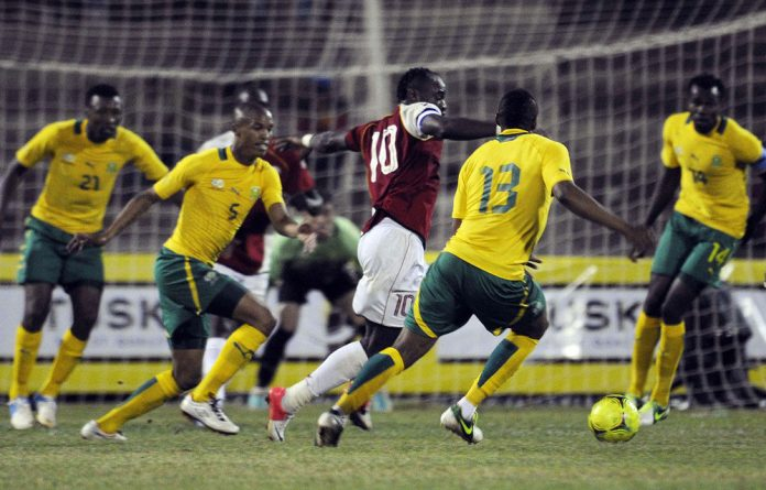 Kenya's Dennis Oliech attempts to dribble past Bafana's defence during an international friendly match between Kenya and South Africa in Nairobi.