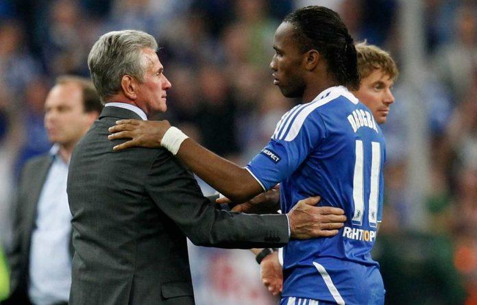 Bayern head coach Jupp Heynckes congratulates Chelsea's Didier Drogba after victory over Bayern Munich on May 19.