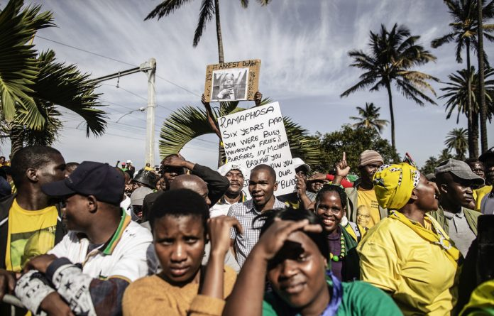 Our man: Ex-president Jacob Zuma's fans wore ANC colours outside court despite the party distancing itself from him.