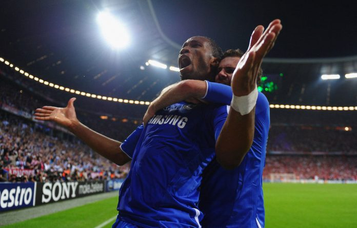 Didier Drogba of Chelsea celebrates with teammate Juan Mata after scoring his team's first goal during Uefa Champions League final.