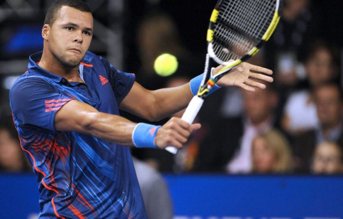 France's Jo-Wilfried Tsonga returns the ball to his Italian opponent Andreas Seppi during their ATP Moselle Open final tennis match.
