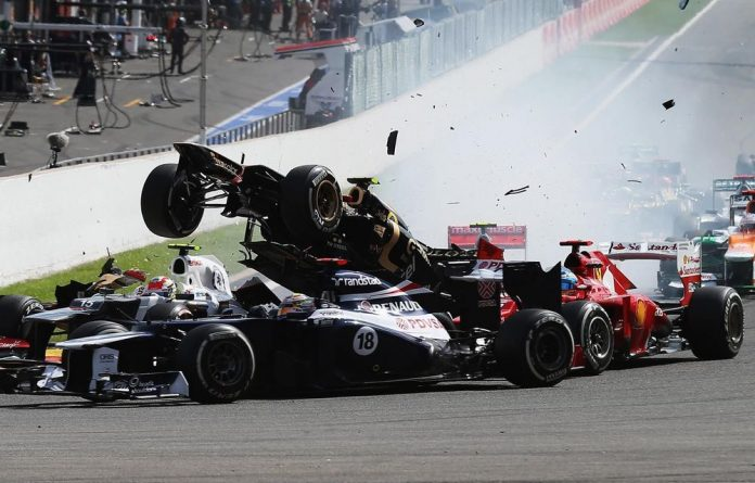 Romain Grosjean of France and Lotus is seen being catapulted into the air as he crashes at the first corner at the start of the Belgian Grand Prix.