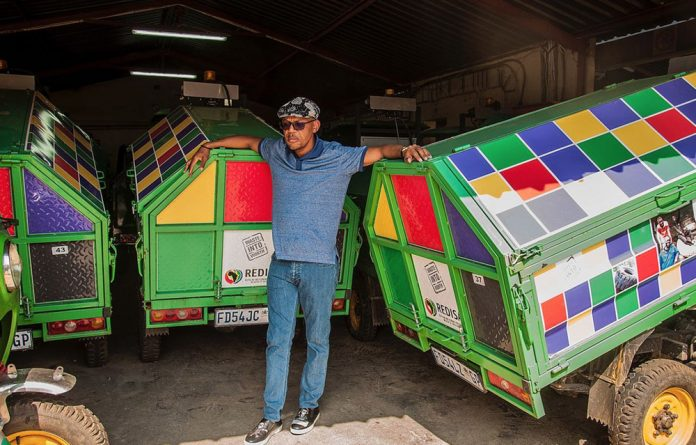 Pule Mabe with some of his three-wheel 'karikis'