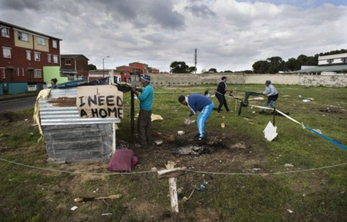 Over the M7 from Mitchells Plain is Siqalo informal settlement. Residents of Woodlands in Mitchells Plain have attempted to claim plots of land on open ground in the community.
