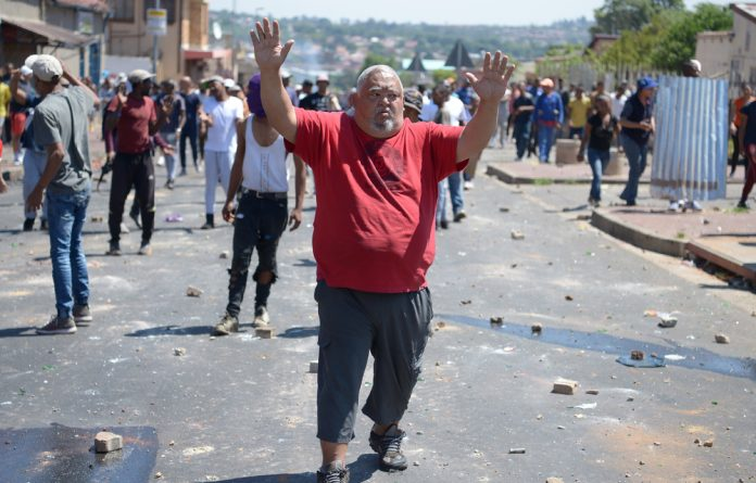 The protests against gangsterism and drug dealing in Westbury were triggered by the shooting death of a woman and the injuring of 10-year-old child during a shootout between alleged gangsters.