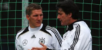 Head coach Joachim Loew talks to Bastian Schweinsteiger during a Germany training session ahead of their Euro 2012 semifinal match against Italy.