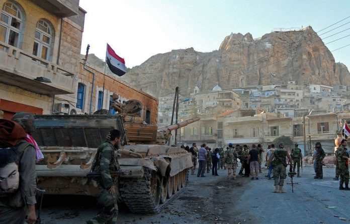 Syrian pro-government troops on the streets of Maalula.