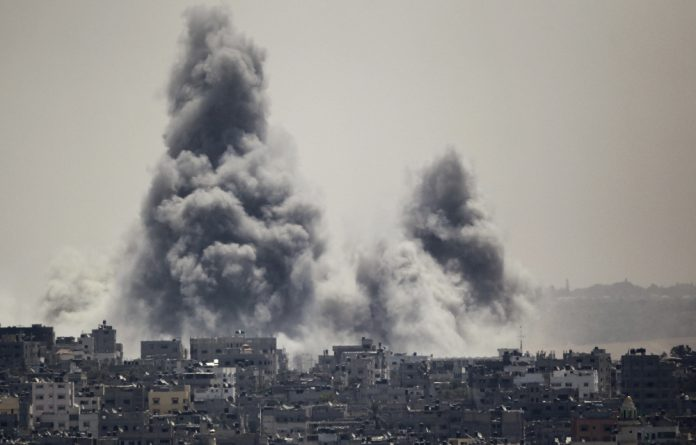 Smoke rises during an Israeli attack in the east of Gaza City on Sunday.