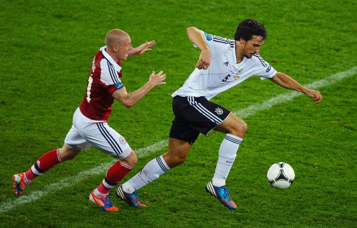 Mats Hummels of Germany is put under pressure by Niki Zimling of Denmark during the Uefa Euro group B match between Denmark and Germany on Sunday.