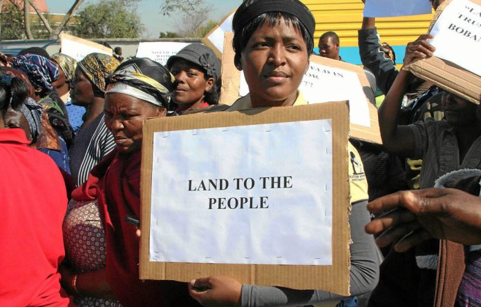 Protesters demonstrate outside Swaziland's Parliament in Lobamba to demand greater access to land.