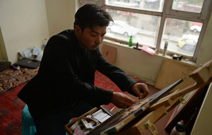 Arif Bahaduri uses medical plasters to make three-dimensional images at his $100-a-month rented studio in south Kabul