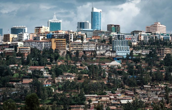 Spotless: A view of Kigali's city centre from the Genocide Memorial. There are some street children in Rwanda's capital