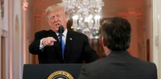 "US President Donald Trump points at CNN's Jim Acosta and accuses him of ""fake news"" while taking questions during a news conference following Tuesday's midterm congressional elections at the White House in Washington"