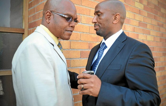 Turning tables: Richard Mdluli and his lawyer Ike Motloung outside court in 2012