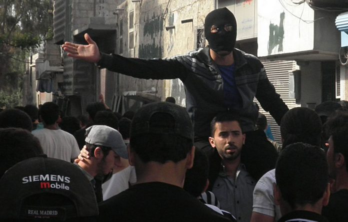 Anti-Syrian regime mourners chant slogans during the funeral procession of Odai Junblat who was shot by Syrian security forces in Damascus