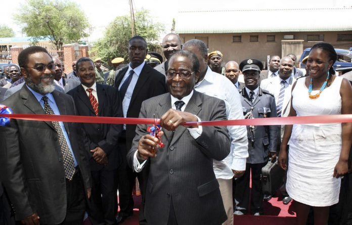President Robert Mugabe opens the Chirundu one-stop border post in 2009.