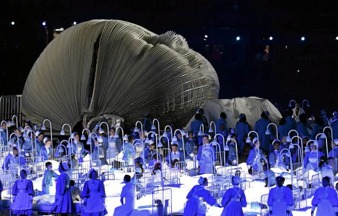 Actors perform in a sequence meant to represent Britain's National Health Service during the 1950s at the opening ceremony of the 2012 Summer Olympics.