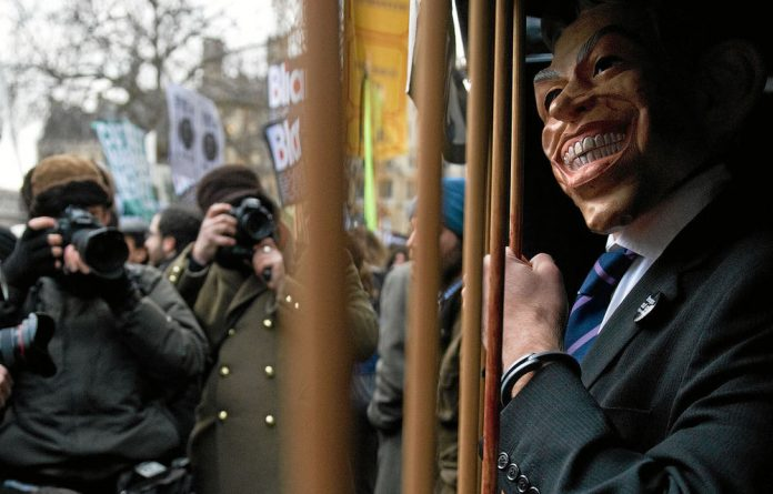 A protester in London epitomises the sentiment against the former British prime minister