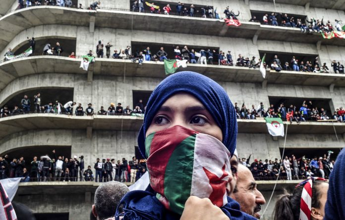Marching on: Tens of thousands of people in Algeria have protested against President Abdelaziz Bouteflika's bid for a fifth term