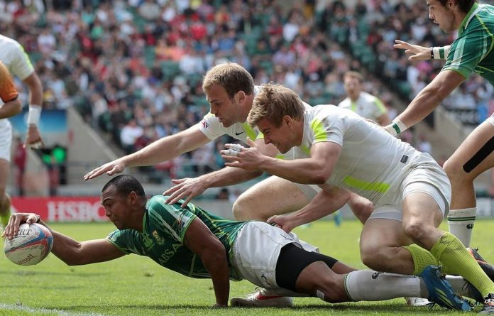 Cornal Hendricks of South Africa scores a try during the Sevens World Series plate semifinal against England on Sunday.