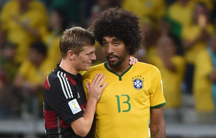 Germany's Toni Kroos consoles Brazil's Dante after their semifinal match in Belo Horizonte.