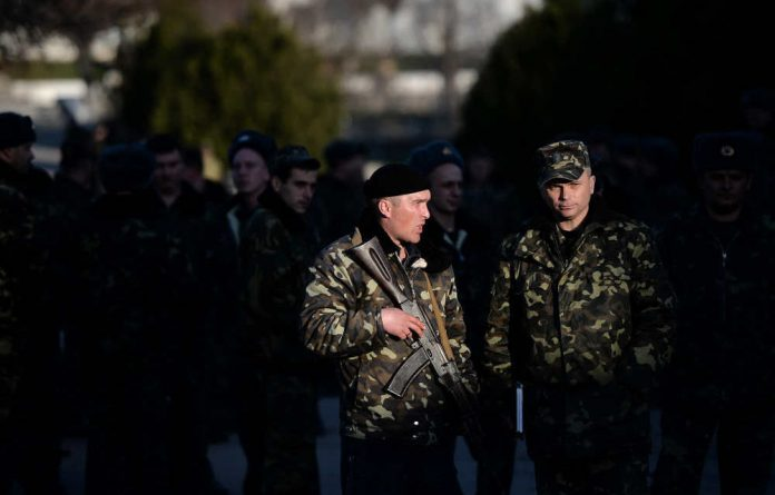 Troops in Crimea have opened fire around the Black Sea