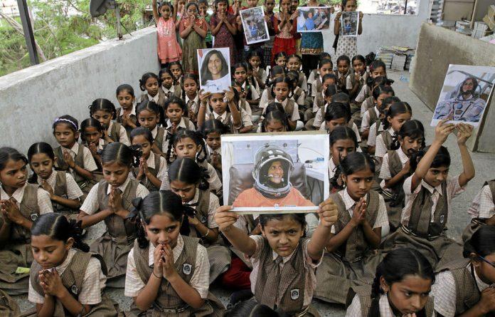 Indian school children hold portraits of astronaut Sunita Williams.
