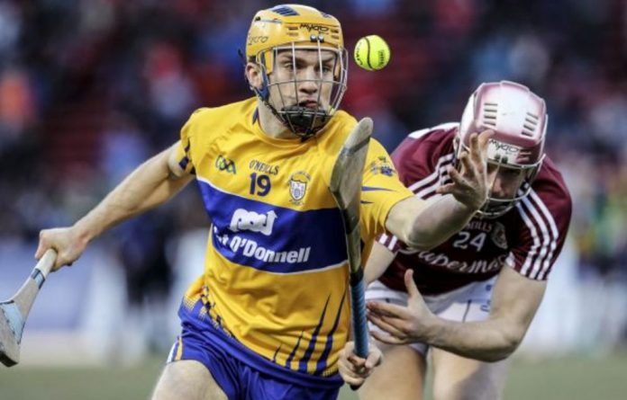 On the ball: Shane O'Donnell of Clare passes Galway's Pádraig Brehony in the Irish festival in Fenway