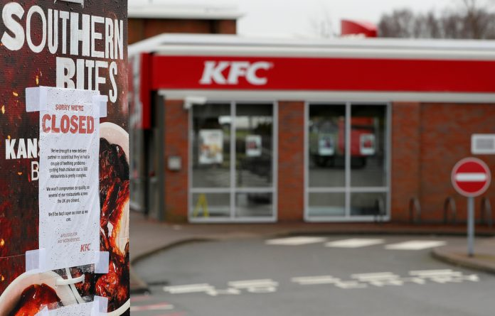 A closed sign hangs on the drive through of a KFC restaurant after problems with a new distribution system in Coalville