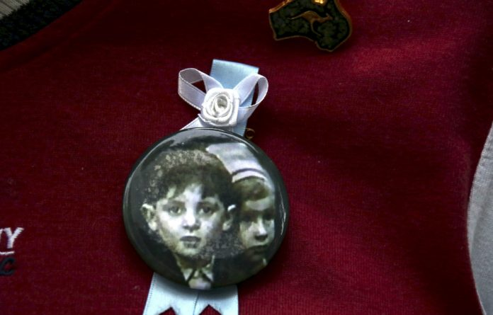 A badge shows others who were abused. A third of those in a grade four photo from St Alipius Parish School in 1974 are dead