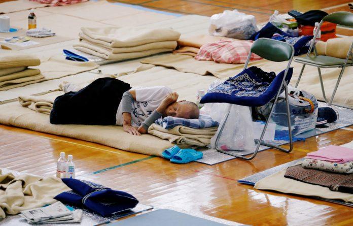 An evacuee rests at Okada elementary school that is used as an evacuation center in Mabi town in Kurashiki