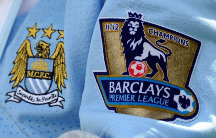 The Barclays Premier League winner's badge on a Manchester City shirt during the victory parade around the streets of Manchester on May 14 2012.