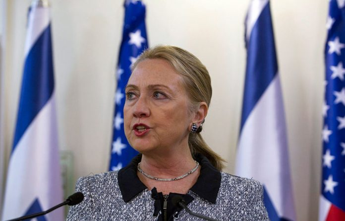 US Secretary of State Hillary Clinton flew to Israel and Palestine to try and broker a truce in the Gaza strip.