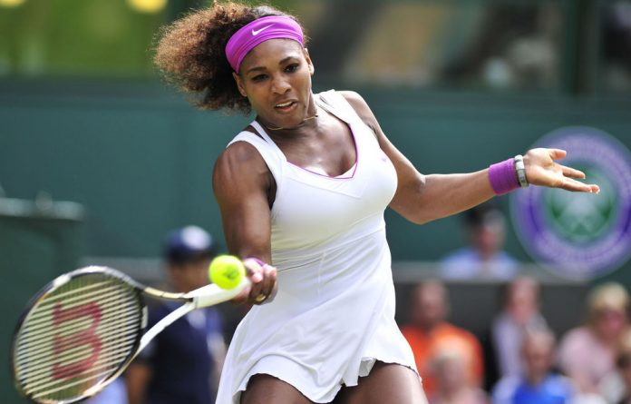Serena Williams plays a forehand shot during her third round women's singles victory over China's Zheng Jie on day six of the 2012 Wimbledon.