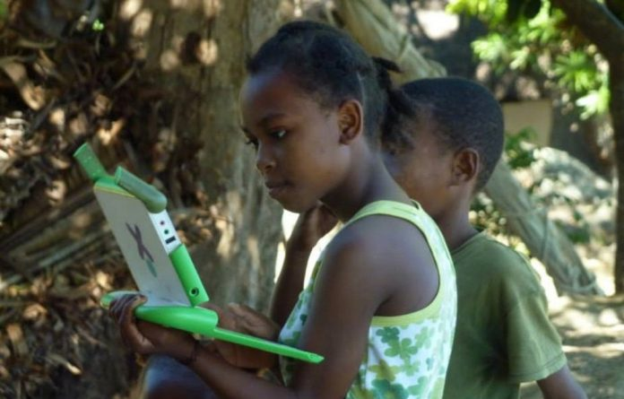 A Malagasy girl works on her laptop.