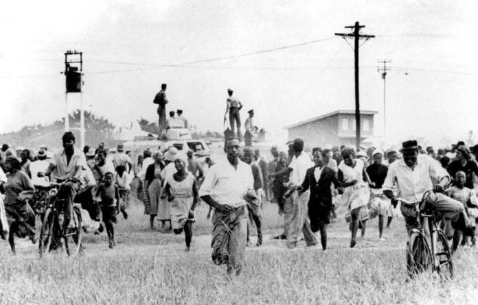 Crowds flee the police during the Sharpeville massascre in 1960.
