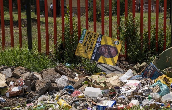 An ANC election campaign poster lies in the rubbish in Sharpeville.