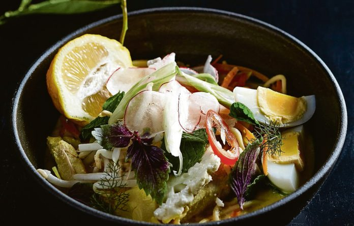 Style on a plate: White fish in coconut milk with noodles.