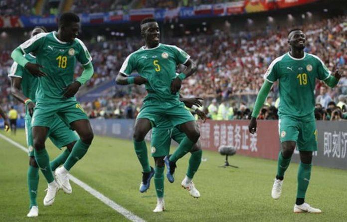 Senegal celebrates a second goal.