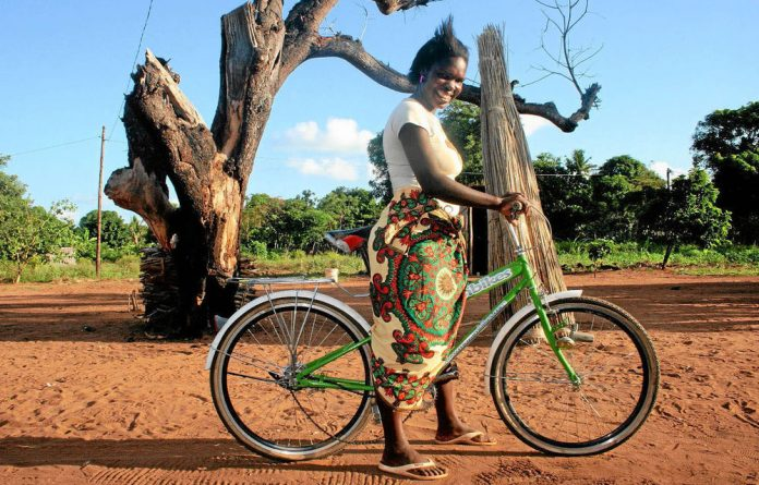 A bicycle provided by Mozambikes has made the life of social worker Florda Salvador Valoi much easier.
