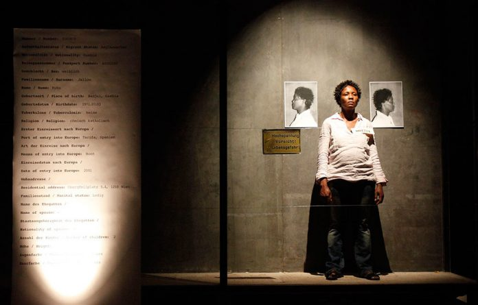 A woman poses in Brett Bailey's art installation 'Exhibit A: German South-West Africa' at the Museum of Ethnology in Vienna on May 16 2010.
