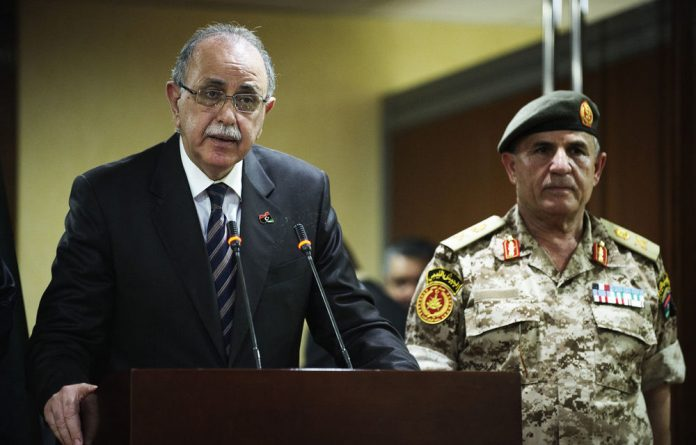 Libyan interim Prime Minister Abdel Rahim al-kib gives a press conference to announce the extradition of former Libyan spy chief Abdullah al-Senussi.
