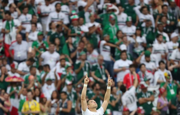 Mexico's Javier Hernandez celebrates scoring their second goal against South Korea.