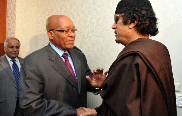 President Jacob Zuma and Libyan leader Muammar Gaddafi met in Tripoli in May 2011. Inexplicably